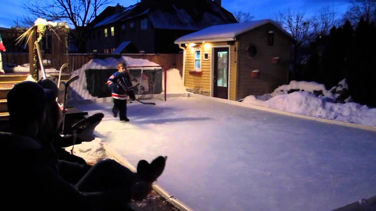 watch dad builds family a backyard ice skating rink youtube