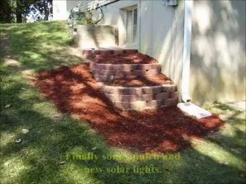 Building A Terraced Retaining Wall And Laying Brick Pavers Youtube