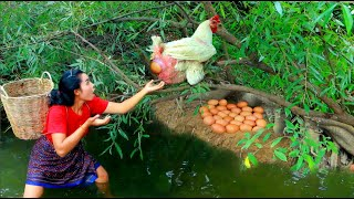 Women find fish for food meet big White Chicken with egg at river - cooking soup for dog eating HD