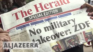 Zimbabwe crisis: Mugabe confined to home as army takes control