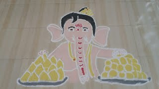 Making Bal Ganesh with laddoos and modak with Rangoli