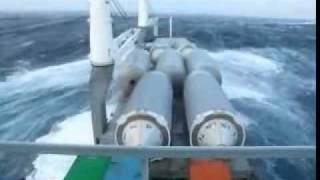 Cargo Ship in Rough Seas Losing Cargo