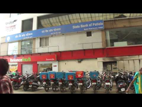 Standing inside & outside Domino's Pizza store in Surat City, Gujarat, India; 25th January 2012