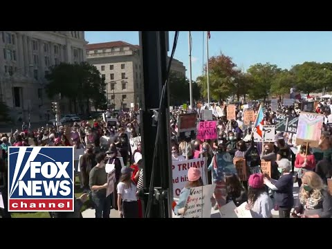 Women's marches take place in cities across the US
