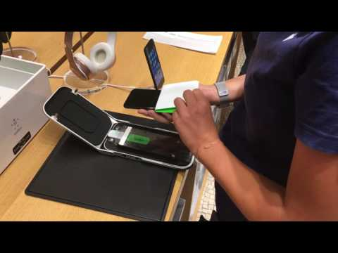 An apple specialist installing screen protector to a new iPhone 7