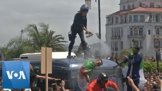 Algeria Police Toppled Off Of Van After Firing Tear Gas At Protesters