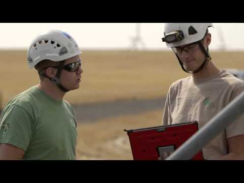 Wind Farm Technicians and High-Tech Tablets at Work