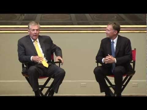 Doug Oberhelman, CEO of Caterpillar Inc., and Kent Adams, Vice President, speak to UGA students