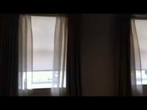 Motorized privacy solar roller shades nyc www for Motorized solar shades for windows