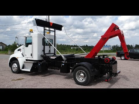 12 - TRUCK: HOOK-LIFT 25,000 LBS CAPACITY