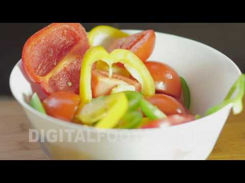 CLIP #1004 / Fresh vegetables falling in an empty white bowl.