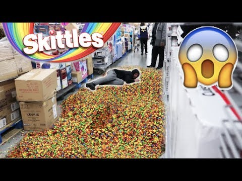FALLING WITH 10,000 SKITTLES IN WALMART!