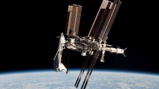 Shuttle docked to ISS, exterior video flyby 2011