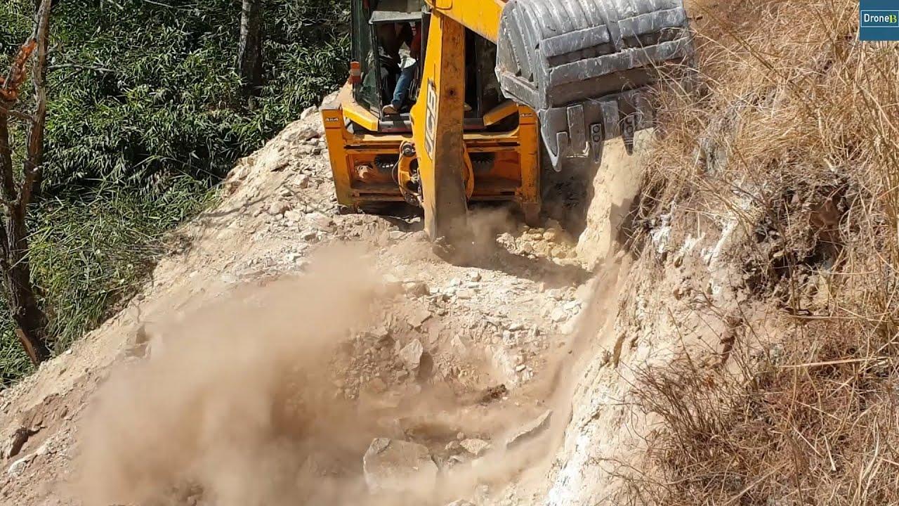 JCB Machine-Rocky Hill-Successfully Breaking Rock-Hilly Road Work