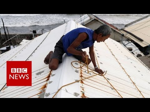 Philippines Typhoon Mangkhut: 'People are tying down their roofs' - BBC News