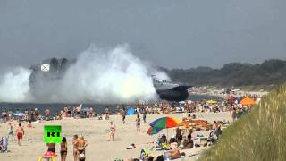 Video: Amphibious landing craft docks at crowded beach in Russia