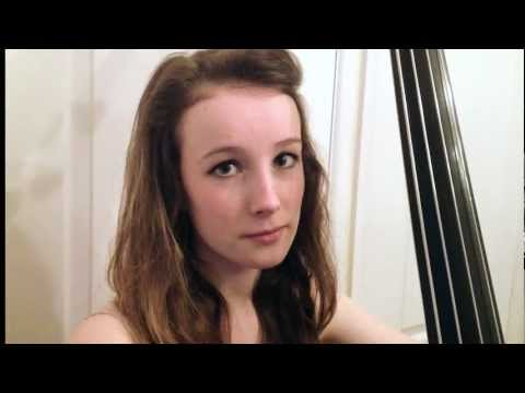 Girl plays double bass wearing only underwear