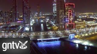 Dubai Canal bridge lights at night(Dubai Canal bridge lights at night. Aerial footage of the night lights on the Shaikh Zayed road bridge over the Dubai Canal. See more at: ..., 2016-11-08T12:29:39.000Z)