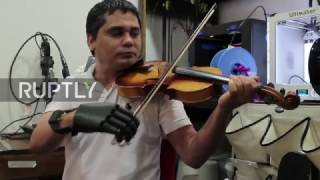 Repeat youtube video Paraguay: Amputee plays violin with 3D printed prosthetic hand
