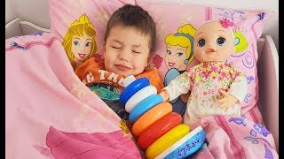 Richard play with Stacking Rings and new Baby Alive doll