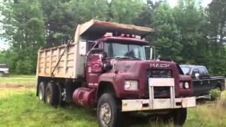 1988 Mack dump truck backing up.