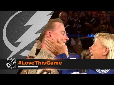 Navy Corpsman surprises parents at Lightning game