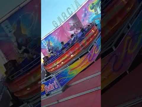 Brave kid Jumps Around on Spinning Wheel Ride - 1002019