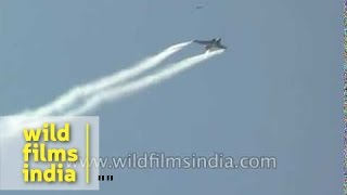 Supersonic fighter jets do powerful maneuvers ; leave jet stream over Indian skies