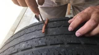 Como reparar una llanta ponchada por un clavo o tornillo