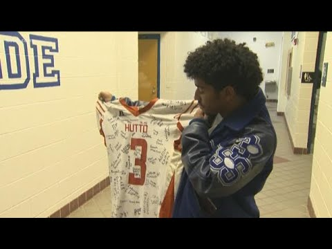 Football rivals from Hutto High School, McCallum High School come together after viral hit