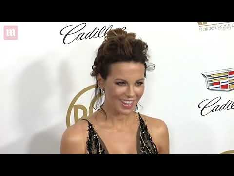 Kate Beckinsale Is The Epitome Of Glamour In Opulent Black Gown With Plunging Neckline As She Leads