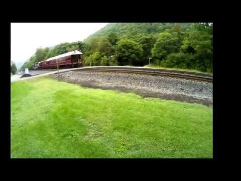 A NS Track Test Train moves through Elliston, Virgina.  Interesting motive power and sick whistle!