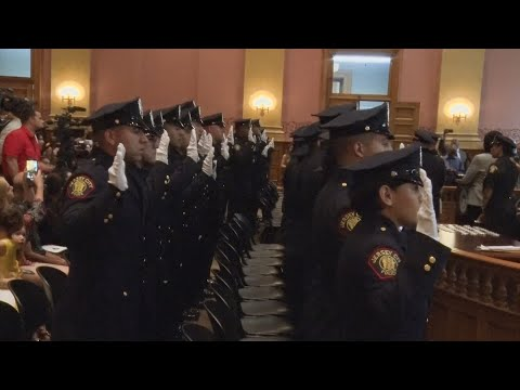 Jersey City swears in new police class, touts drop in crime