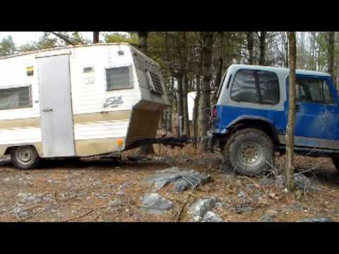 my reality jeep life 92 ole blue pulls camper thru the trails