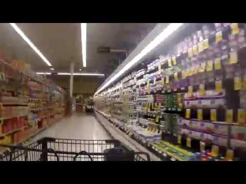 4k Time-lapse of shopping cart walking through aisle of Supermarket