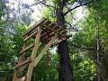Homemade wooden ladder stand.