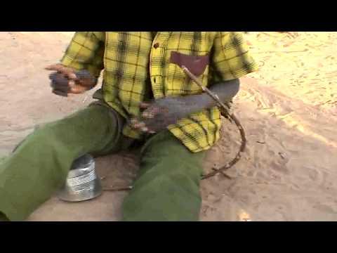 Young Bozo boy playing a musical bow (Mali)