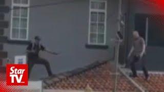 Heroic neighbours nab burglar who falls off roof
