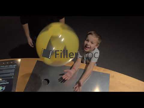 Ball floating in air stream. Experiment at science centre