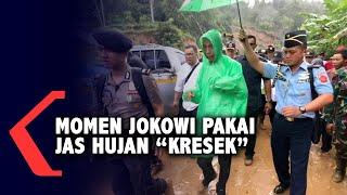 Kehujanan saat Tinjau Korban Banjir, Jokowi Pakai Jas Hujan Kresek Rp10 Ribu