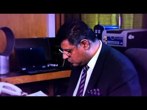 Tan Ikram - District Judge