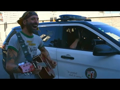 Protester sings Snow Patrol to cops at Police Brutality March - By Rob Potylo