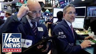 Stocks drop as interest rates spike