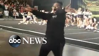 Cheerleading coaches go wild on sidelines as squad nails their routine