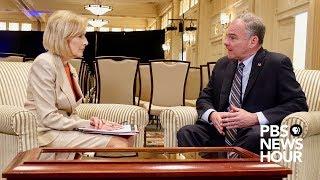 Sen. Tim Kaine speaks with Judy Woodruff after the first 2018 U.S. Senate debate in Virginia