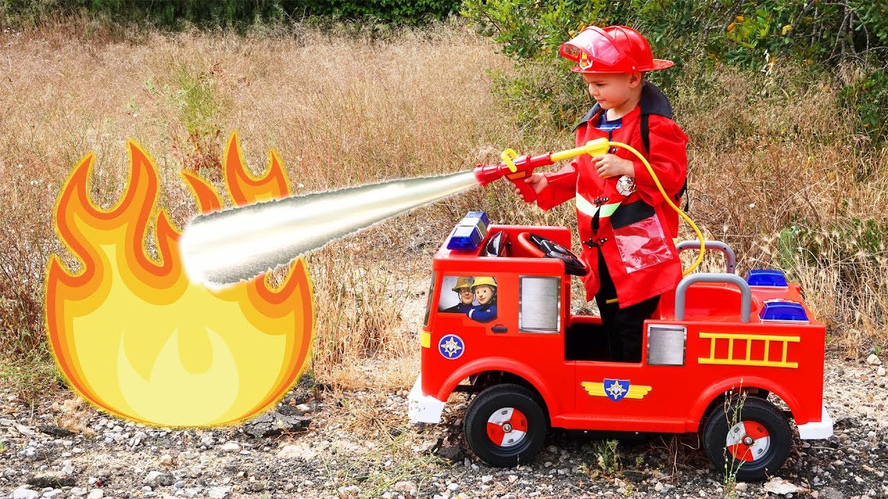 Fireman Dima on power wheels fire truck working on the street