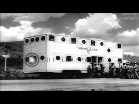 Western Army troops boarding biggest motor bus in Colorado Springs, Colorado. HD Stock Footage