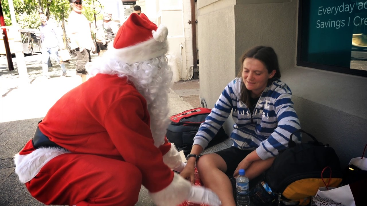 Santa Giving Presents To The Homeless