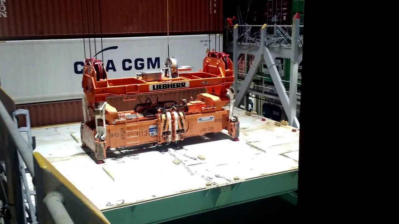 Crane taking a hatch cover off a container ship