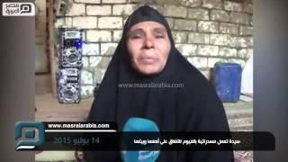 مصر العربية |  سيدة تعمل مسحراتية بالفيوم للانفاق على أهلها وبيتها
